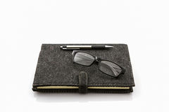 Black book with glasses and pen. Royalty Free Stock Image