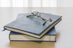 Black book with glasses and pen Royalty Free Stock Image