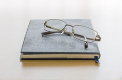 Black book with glasses Stock Images