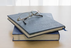 Black book with glasses Stock Image