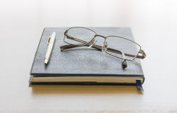 Black book with glasses Stock Photo