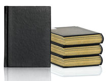 Black book is laying with shadow on white background Royalty Free Stock Images