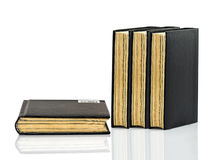 Black book is laying with shadow on white background Royalty Free Stock Photo