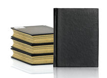 Black book is laying with shadow on white background Stock Photo