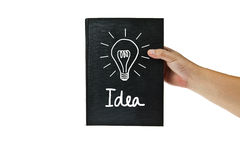 Black book with lightbulb idea Stock Photos