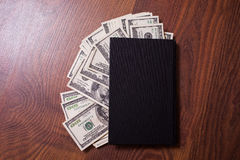 Black book and money,business plan Stock Photography