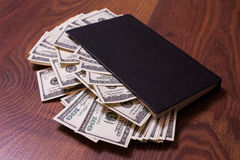 Black book and money,business plan Royalty Free Stock Photos