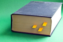 This is black book with yellow bookmarks. It is theme of reading Royalty Free Stock Photos