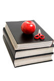 Black books, scissor and apple isolated. On white Stock Photography