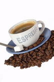 Black Boost. Expresso coffee with sugar over roasted coffee beans Royalty Free Stock Photos