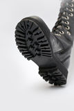 Black boot. On a white background Royalty Free Stock Image