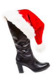 Black boot with santa hat Royalty Free Stock Images