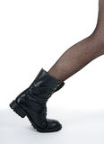 Black boot stepping out of the picture Stock Photos