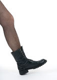 Black boot stepping into the picture Stock Image
