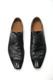 Black boot on white background Stock Photos