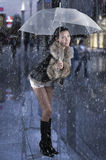 Black boot white short. Pretty brunette black boot white short under white umbrella Royalty Free Stock Images