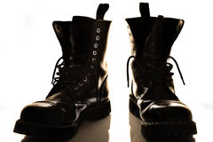 Black boots. Black military boots in shadow Royalty Free Stock Photo