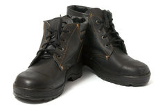 Black boots. Black work boots isolated on white background Royalty Free Stock Photo