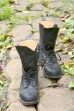 Black boots. Two black boots on the ground Stock Photo