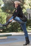 Black boots. Portrait of African-American girl  in jeans and boots (focus on boots Royalty Free Stock Photos