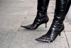 Black boots. Woman in black boots with high heels Royalty Free Stock Photo