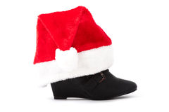 Black boots with christmas hats Royalty Free Stock Image