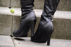 Black boots with heels Stock Photography