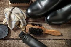 Black boots,polisher,brush and polish cream Stock Photography