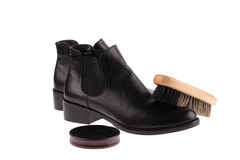 Black boots with shoe brush Royalty Free Stock Photography