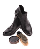 Black boots with shoe brush Royalty Free Stock Image