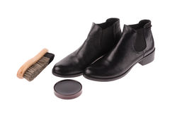 Black boots with shoe brush Royalty Free Stock Photo