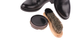 Black boots with shoe brush Stock Image