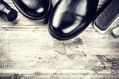 Black boots and shoe care accessories. Copy space Royalty Free Stock Photos