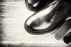 Black boots and shoe care accessories Stock Photo