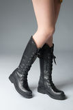 Black boots on woman legs Stock Images