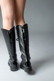 Black boots on woman legs Stock Photo