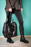 Black boots on woman legs and handbag Royalty Free Stock Photo