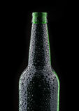 Black bottle of beer Stock Photography