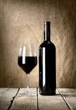 Black bottle and glass Royalty Free Stock Photo