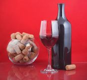 Black bottle and red wine Stock Photo