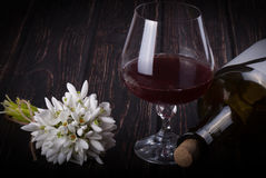 Black bottle of wine and wineglass Royalty Free Stock Photo