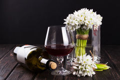Black bottle of wine and wineglass on the wood background Royalty Free Stock Photography