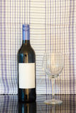 Black bottle of wine and wneglass Stock Photography