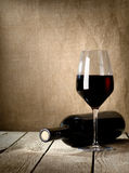 Black bottle of wine and wneglass Stock Photos