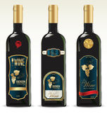 Black bottles for wine with gold and brown labels Royalty Free Stock Images