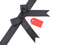 Black bow with red label Stock Photos