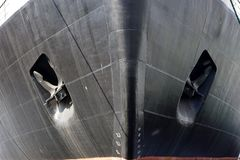 Black bow of a ship with anchors. stock photography