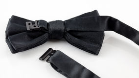 Black bow tie. A close up of the back of a bowtie showing its fastener stock photos