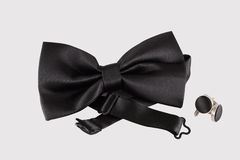 Black bow tie  with cuff links. On white background Royalty Free Stock Photography