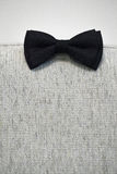 Black bow tie on a textile background. Indoor shot with artificial light Stock Photography